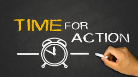 Time for action. Concept on blackboard background Stock Images