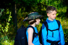 Time for adventure. Two boys friends go hiking with backpacks. Summer holidays. Outdoor activities Stock Image