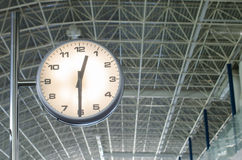 On time. The airport clock marks the time of shipment Stock Photography