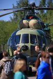 The Mi-8 helicopter cockpit and people passing by. Close-up Stock Photography