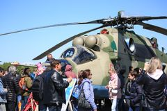 People near russian attack helicopter Mi-24 on airshow. Time of the airshow on Pushkin airdrome June 4, 2017. Saint-Petersburg, Russia royalty free stock image
