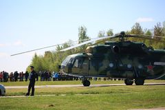 Russian multipurpose helicopter Mi-8 and people on the airfield on a sunny day royalty free stock photography