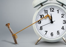 Time on alarm clock stop by nail, delay concept. Time on clock stop by nail, delay concept Stock Photography