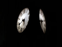Time. An analog clock with black background Stock Photo
