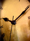 Time on an antique clock. Warm hued Stock Photo