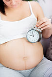 Time for baby,pregnant woman with clock Stock Images