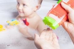 Time for baby's bath Stock Image