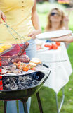 Time for barbecue in a garden royalty free stock images