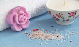 Time for bath. Floral soap, towl, bath salt and candle Stock Photos