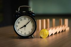 Time for bitcoin with alrm clock, Stock exchange concept Royalty Free Stock Images