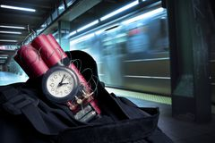 Time bomb inside a backpack in a subway station Royalty Free Stock Photo