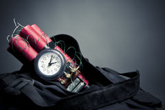 Time bomb inside a backpack in a subway station Stock Photo