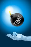 Time bomb. Round black  time  bomb with a burning fire on hand, spend time concept Stock Photo