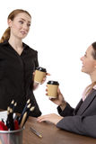 Time for a break!. Shot of two pretty female collegues enjoying a coffee Royalty Free Stock Photography