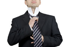 Time for business. Young business man adjusting his tie Royalty Free Stock Photography