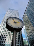 Time And Business. Concept image representing time and business. Taken next to Canary Wharf in London's Docklands Royalty Free Stock Photos
