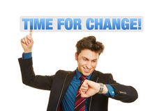 Time for Business Change!. As concept for a business man checking his watch Royalty Free Stock Photos