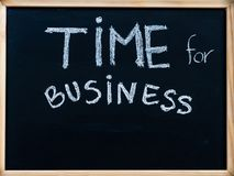 Time for business message handwritten with white chalk on wooden frame blackboard Stock Images