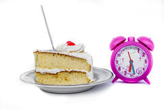 Time with cake. Delicious slice of cake with clock royalty free stock photos