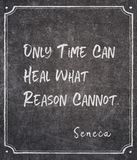 Time can heal Seneca quote. Only time can heal what reason cannot - ancient Roman philosopher Seneca quote written on framed chalkboard stock photos