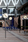 Time, Canary Wharf offices in London, UK. Architecture and clocks in the Canary Whalf area in London, United Kingdom Stock Photo