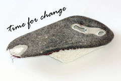 Time for change. Worn-out slippers with the words time for change Royalty Free Stock Photography