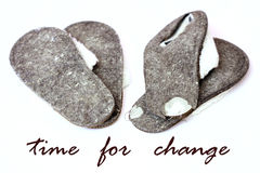 Time for change. Worn-out slippers with the words time for change Royalty Free Stock Image