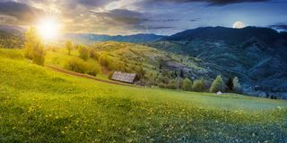 Time change above the rural field in mountains royalty free stock photo