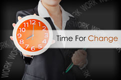 Time for change. Time for change with Business wooman showing clock with holding document. Business concept Royalty Free Stock Photo