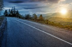 Time change concept of countryside mountain road. Lovely autumnal scenery Royalty Free Stock Photo
