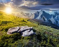 Time change concept over the composite landscape. With meadow in rocky mountains. beautiful unrealistic landscape in summertime with sun and moon Royalty Free Stock Photography