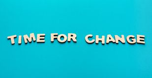 Time for change inscription on blue background stock images
