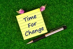 Time for change in note. Time for change in sticky note with pen and dried rose buds on grass Royalty Free Stock Photos