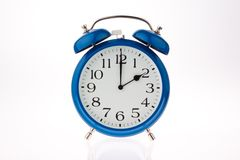 Time change from summer time. Alarm clock as a symbol of time change from summer to winter time Stock Photo
