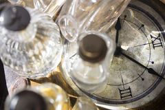 Time charm and perfumes Royalty Free Stock Image