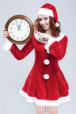 Time and Christmas Holiday Concept and Ideas. Gleeful Red-Haired Santa Helper With Big Round Clock Stock Image