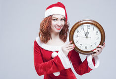 Time and Christmas Holiday Concept. Portrait of Smiling and Gleeful Red-Haired Santa Helper Stock Photography