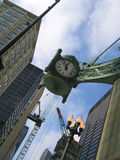 Time clock. And balanced point of view between the high tower - Chicago Royalty Free Stock Images