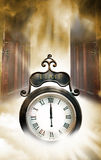 Time clock. A iron black clock with a cloudy stormy backdrop. Two old wooden doors opening to represent a new beginning. Concept for eternal time or now is the Stock Photography