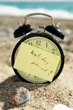 Time clock alarm clock at sunny beach Stock Photos