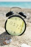 Time clock alarm clock at sunny beach dst Royalty Free Stock Image