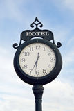 On time. Clock with hotel sign in Victorian-style Stock Photography