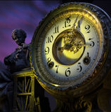 Time clock with statue Stock Photography