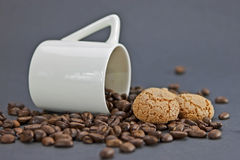 Time for a coffee. Cup of coffee and coffee beans Royalty Free Stock Images