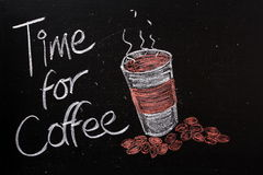 Time for Coffee. A blackboard sign with the phrase Time For Coffee and a take away cup of hot coffee with coffee beans Royalty Free Stock Image
