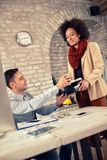 Time for coffee in office. Time for coffee for young male employee in office Stock Images