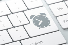 Time concept: Alarm Clock on computer keyboard Royalty Free Stock Photo