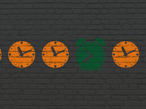 Time concept: alarm clock icon on wall background Royalty Free Stock Images