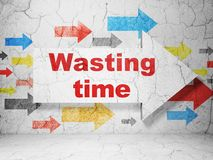 Time concept: arrow with Wasting Time on grunge wall background. Time concept:  arrow with Wasting Time on grunge textured concrete wall background, 3D rendering Royalty Free Stock Photography