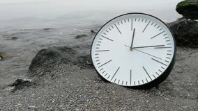 Time Concept Background, Clock Rock Stone Sand Beach Sea Ocean Wave. Time Concept Background, White Wall Clock with Black Arrows on Rock Stone Sand Beach Wave stock video